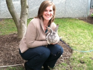 Attorney Emily Sumner with a bunny (on a leash) that appeared outside her office window the day of filing the H-1B cap cases in 2013